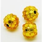 Kivikestega akrüülhelmes 12-11mm, ava 2-2,5mm kollane, pakis 1 tk
